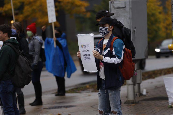 A PSUO-SSUO member protesting