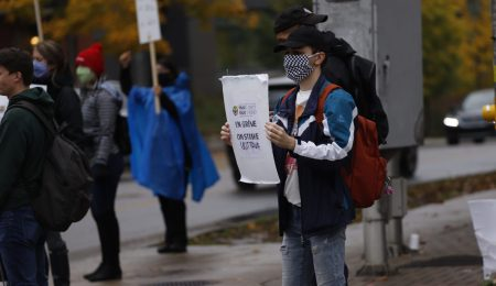 A PSUO-SSUO member protesting