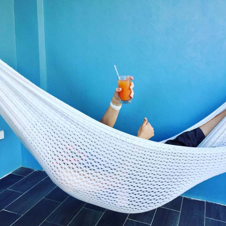 Brooke in the hammock with a drink