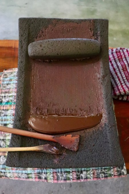 Cacao paste on grinding stone