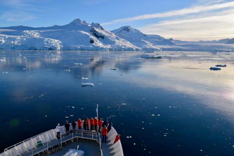 front of ship cruising through icebergs