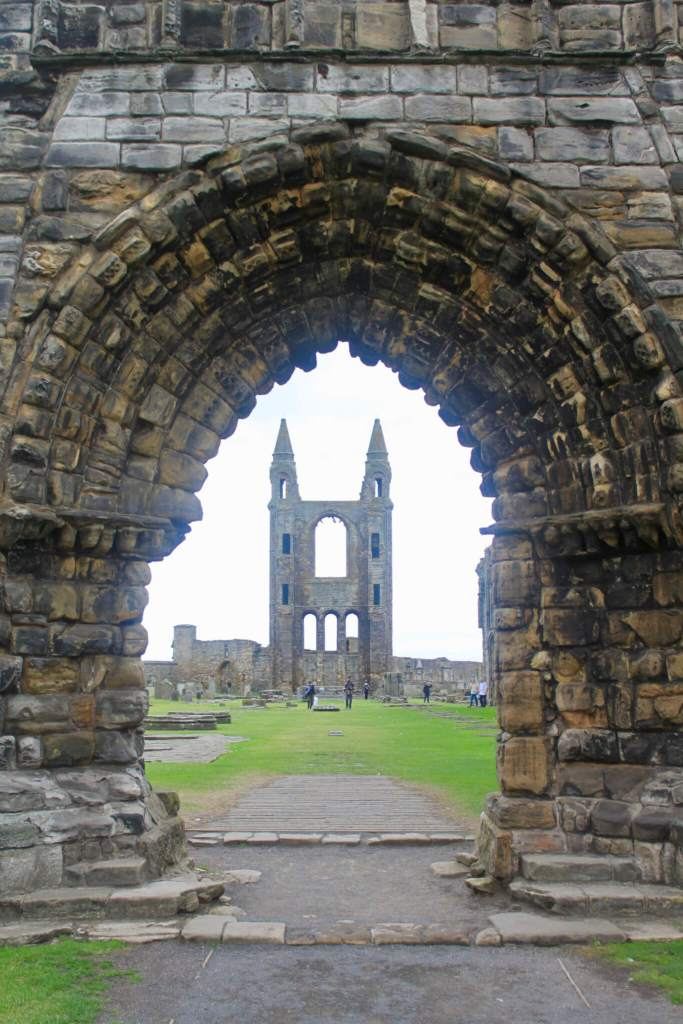 View of ruined towers of St. Andrews Cathedral as seen through open entryway in other ruins