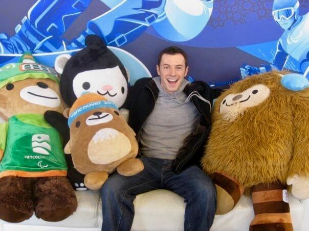 Max with stuffed Olympic mascots