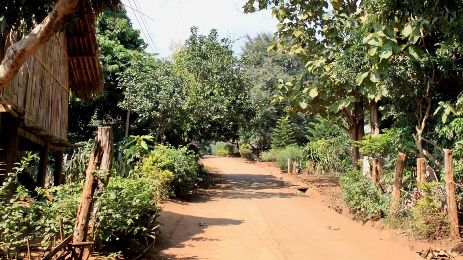 Dirt path through a village in rural Thailand