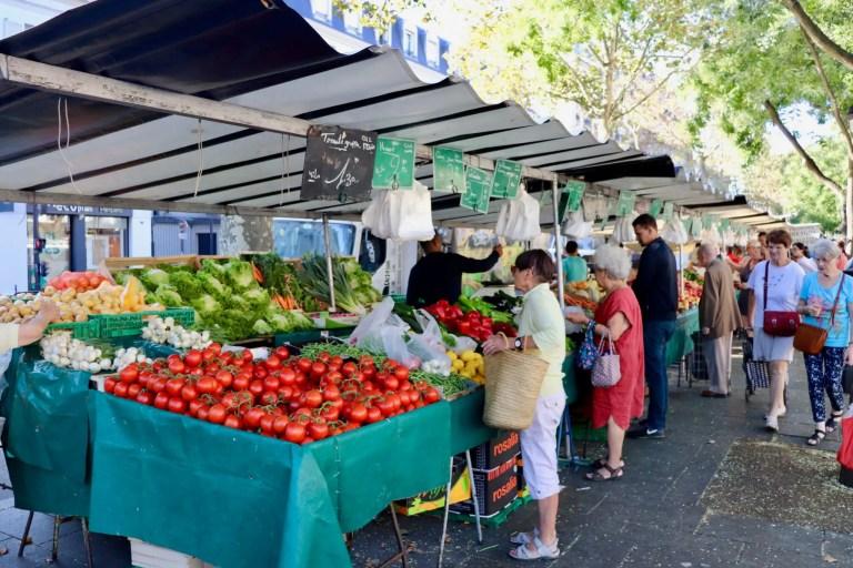 Produce vendor at the Marche Bastille outdoor market