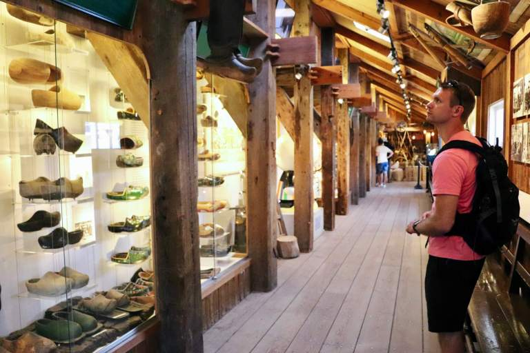 M looking at the wooden shoes in the museum in Zaanse Schans