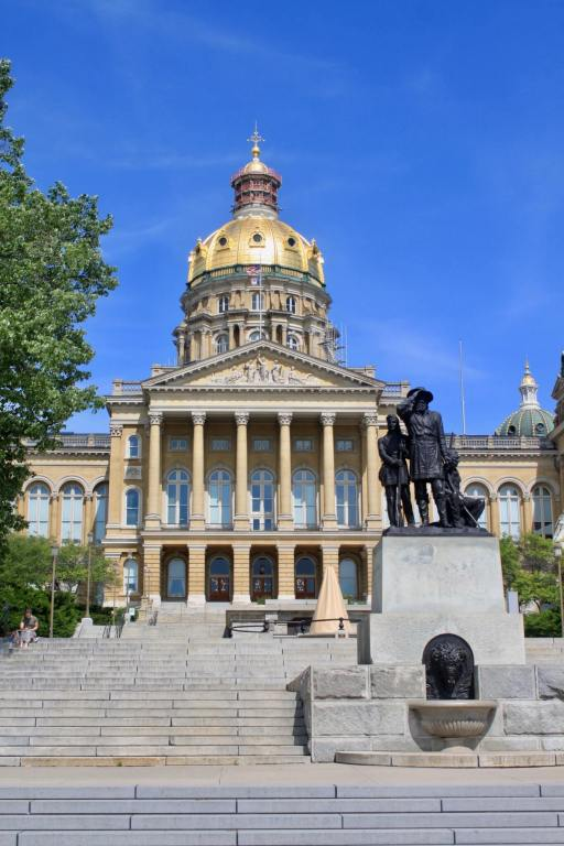 Front view of Iowa capitol building with golden dome and statue in front
