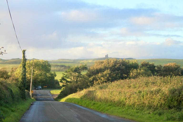 Country road and castle in the distance on the Mullaghmore Peninsula