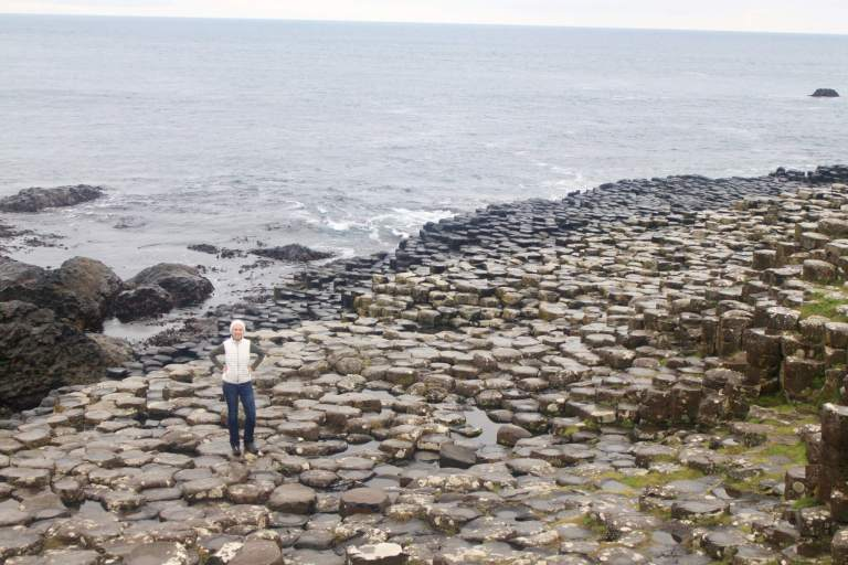 Gwen on the Giant's Causeway with ocean behind