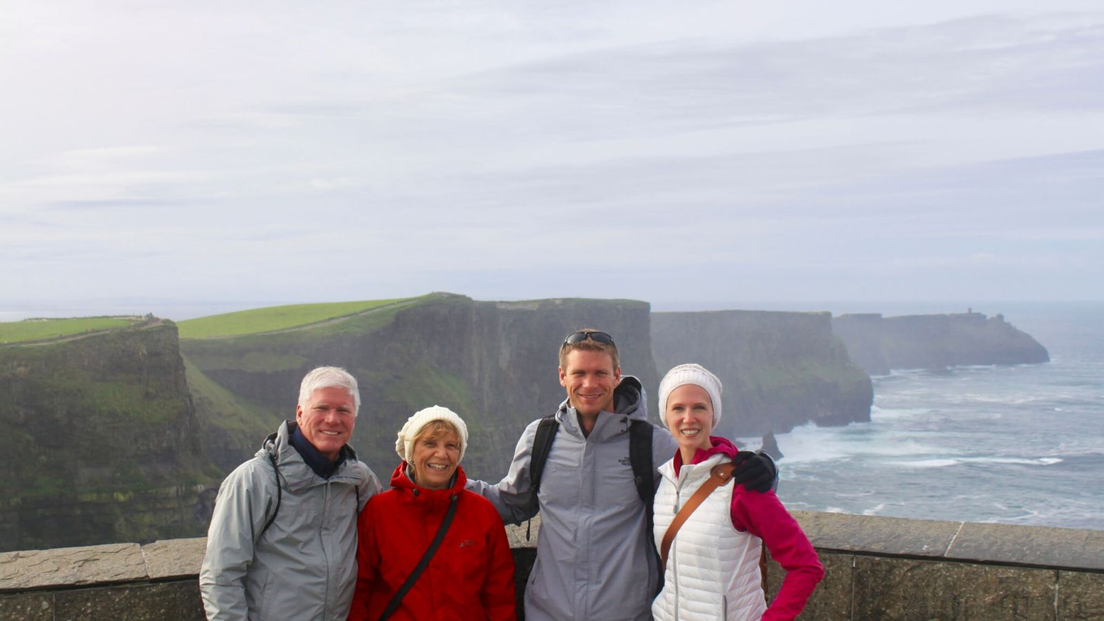 Gwen, M, and M's parents in front of the Cliffs of Moher