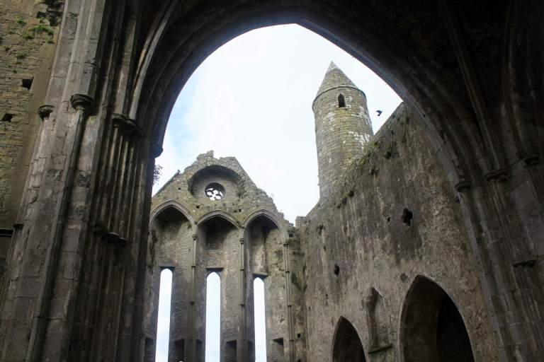 Interior of Rock of Cashel - stone cathedral walls with no roof open to the sky