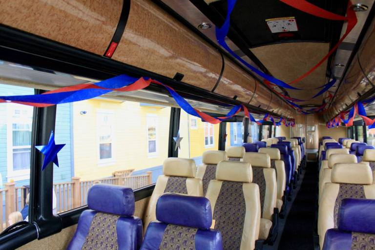 Interior of a motor coach bedecked in patriotic streamers and stars