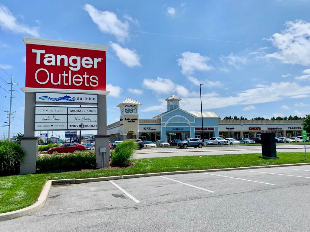 Tanger Outlet sign in front of stores