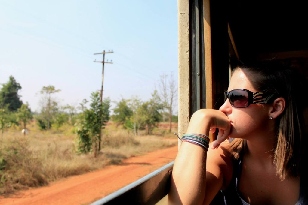 Katie staring out the open train window