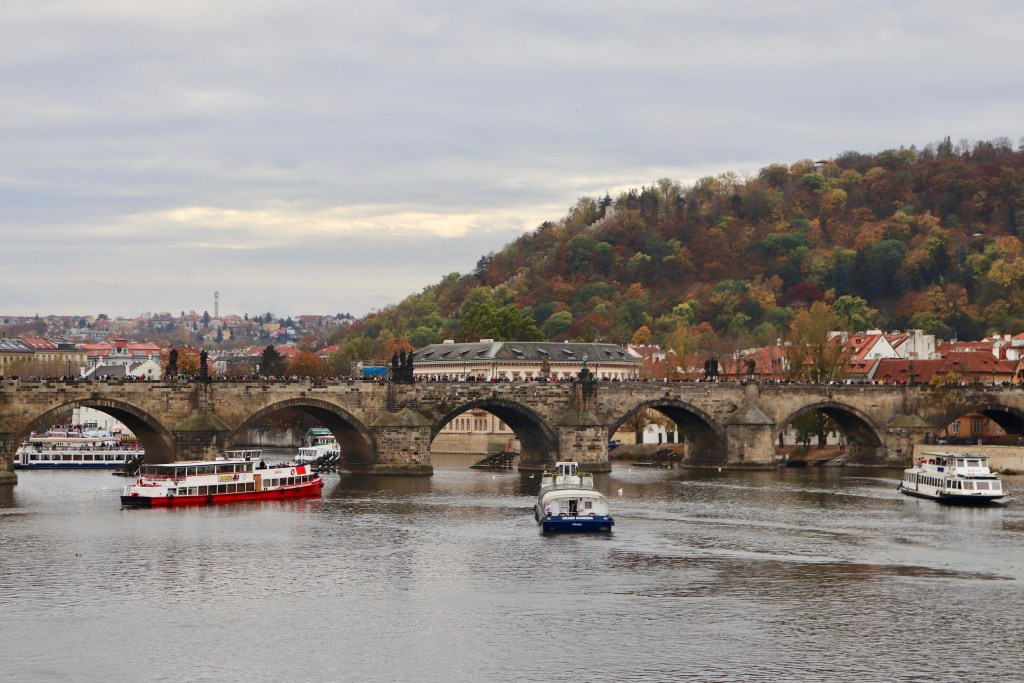 The Charles Bridge during the day, with tons of visitors visible upon it