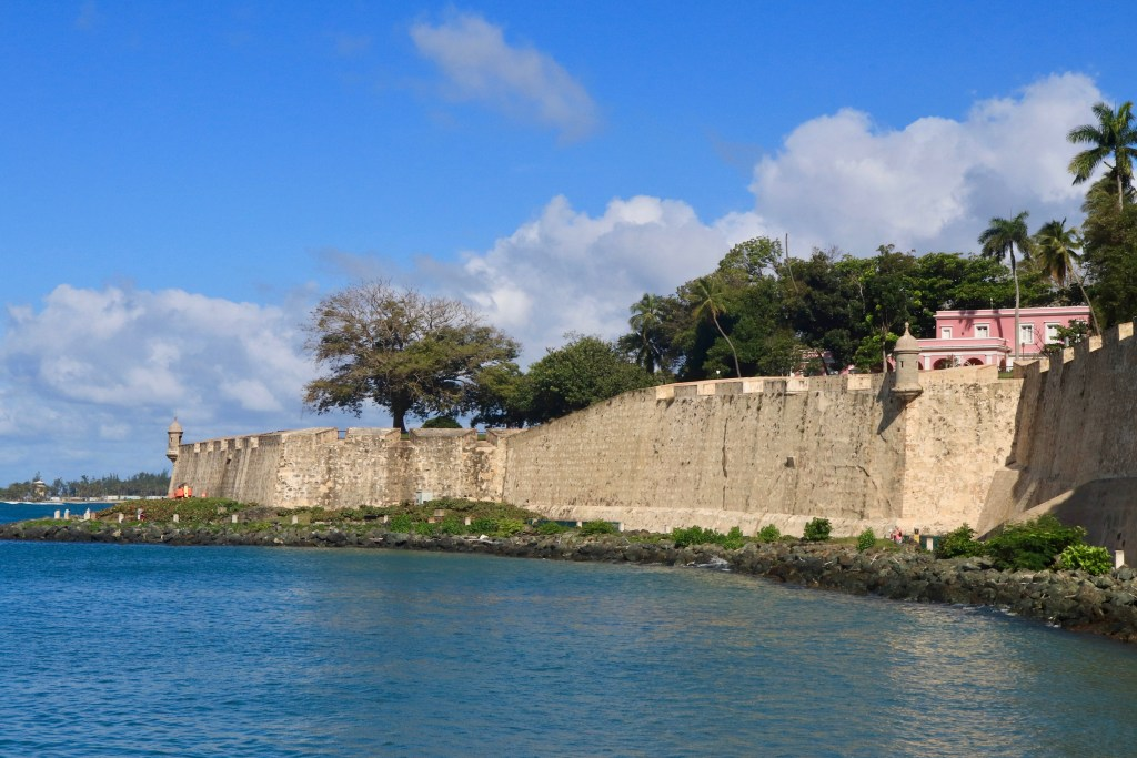 City walls of San Juan with garitas and bay