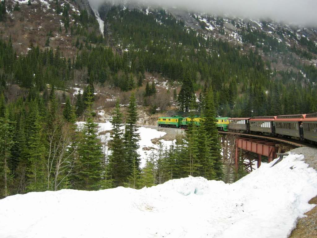 The White Pass & Yukon Route train winding its way up the snowy White Pass. Not only is the WPYR on Alaska bucket lists, but many train enthusiasts' buckets lists as well.