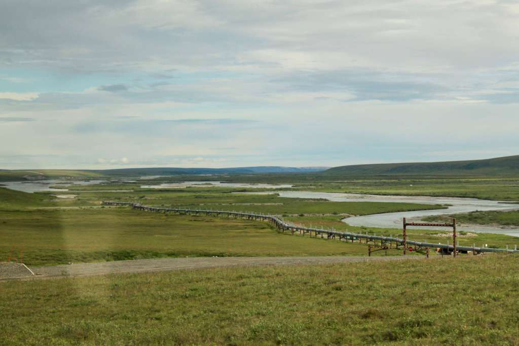 The Alaska pipeline stretching off into the distance as seen from the Dalton Highway