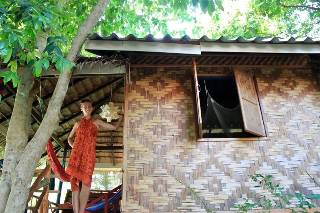 Gwen in front of her beach bungalow in Thailand