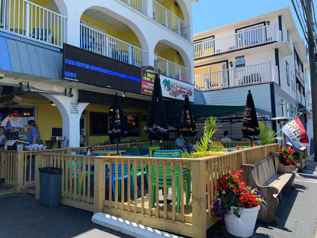Colorful porch area at Woody's, one of the best restaurants in the Rehoboth Beach area for crab cakes