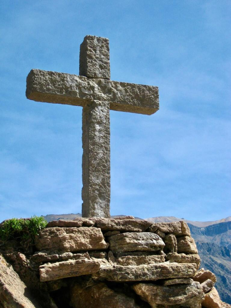 Stone cross on the edge of Colca Canyon