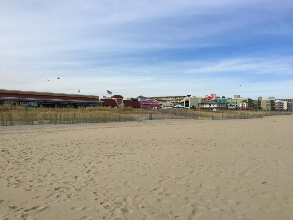 Empty sand in front of the Rehoboth Beach boardwalk during the off-season