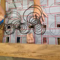 Positioning and stitching our coil springs into our webbing.