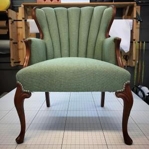 Modern chair with channeled back