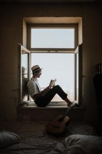 Why reading is important for personal growth looking out a window