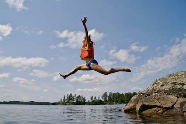 girl jumping into water with excitement how are you excited to improve your dietetic internship application this summer?