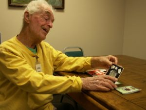 Struckmeier smiles as he looks through some of the greeting cards he has made over the years for Rachel Cataldo, supervisor of the Gulfport Multipurpose Senior Center.