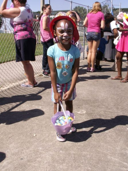 """Alyssa Gipson, 5, of St. Petersburg, shows off the Easter eggs she collected Saturday at Gulfport's Fun in the Sun event. """"We're having a great time,"""" said her mother Ineke Gipson. She said Alyssa's favorite activity was climbing on the fire truck """"because she wants to be a firefighter."""""""