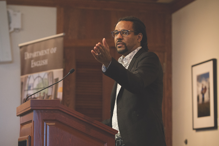 author Colson Whitehead speaking with raised hand