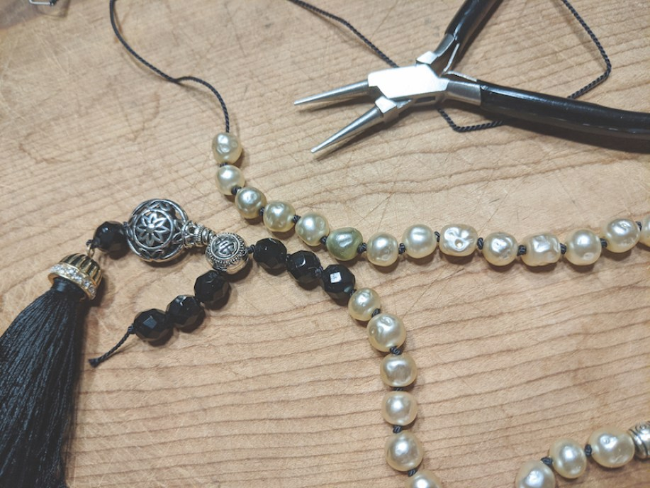 Mala necklace and jewelry making tools.