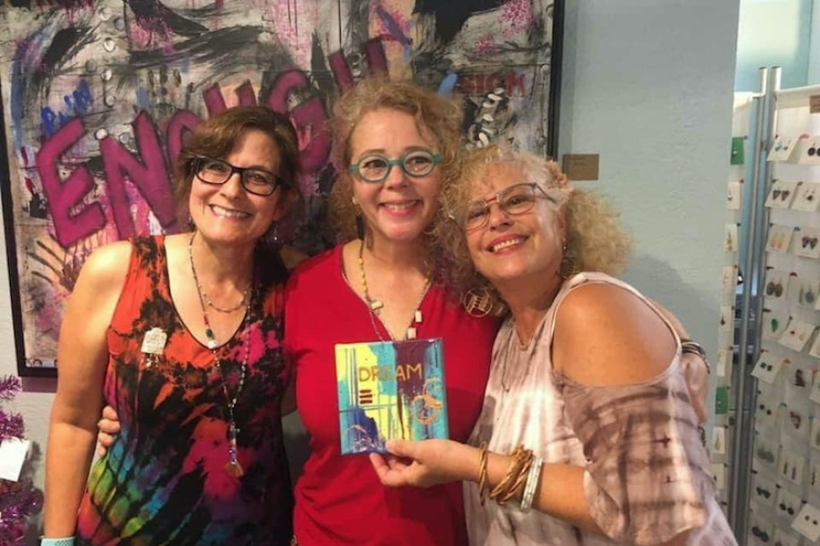 Artists Anne Marie Fraley, Margo Dalgetty, and Dawn Marie display some of their art.