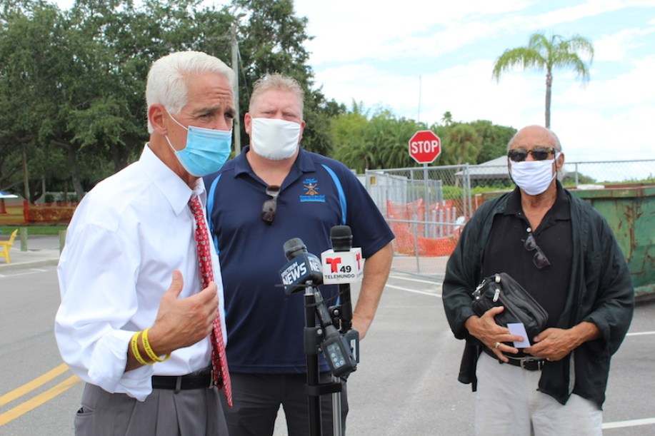 Congressman Charlie Crist, left, with Gulfport Mayor Sam Henderson and Councilmember Michael Fridovich on Wednesday, August 12.