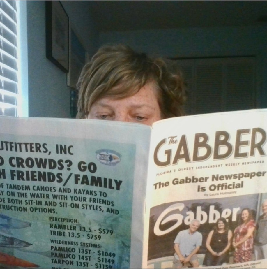 Woman reading the Gabber Newspaper Gulfport florida