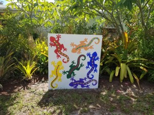 multicolored gecko painting in a garden.