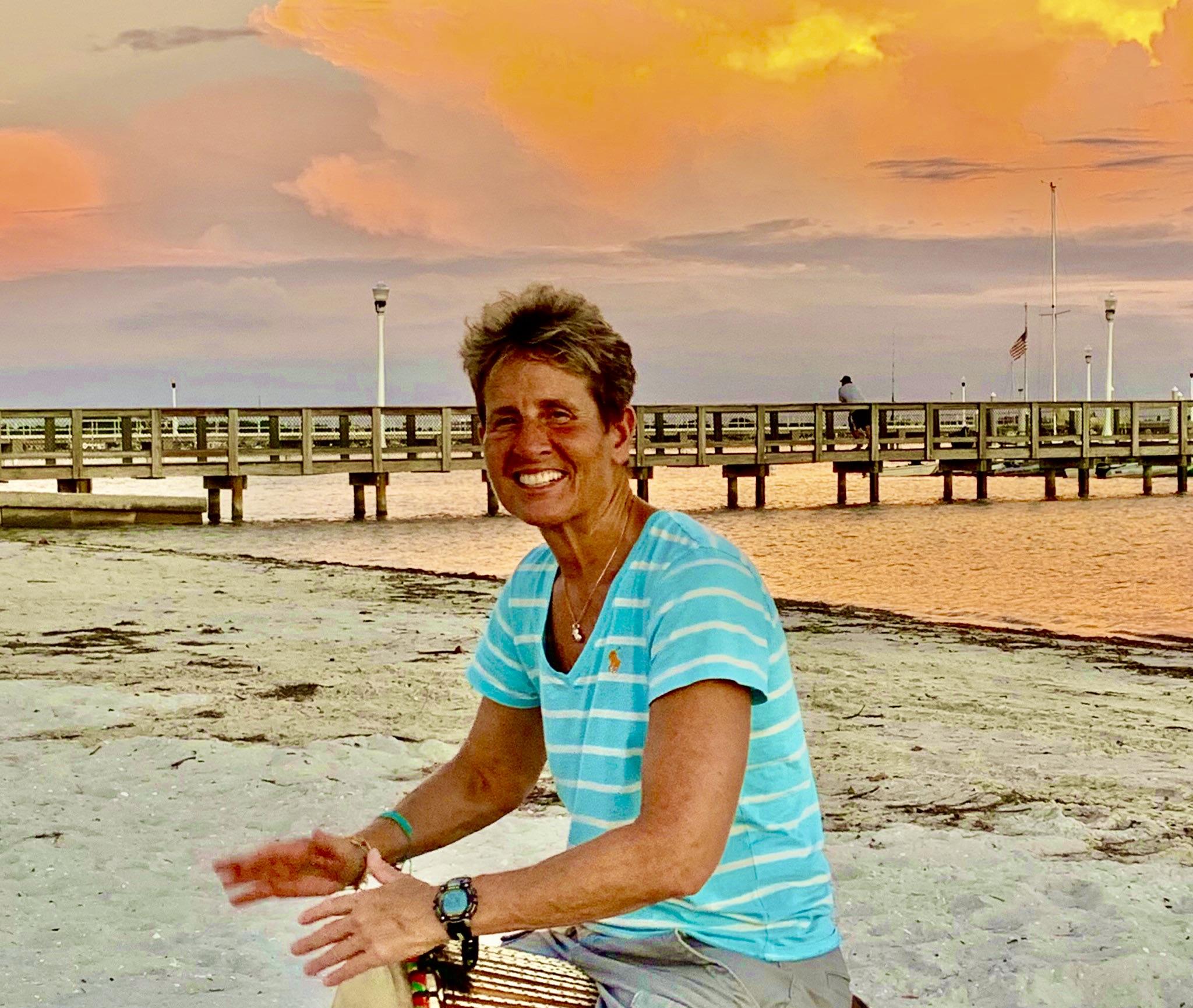 woman drumming on Gulfport Florida beach