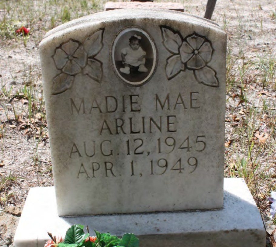 """A grave stone for """"Madie Mae Arline"""""""