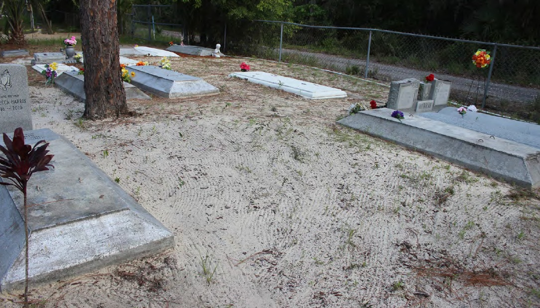 Gravestones in a sandy soil.