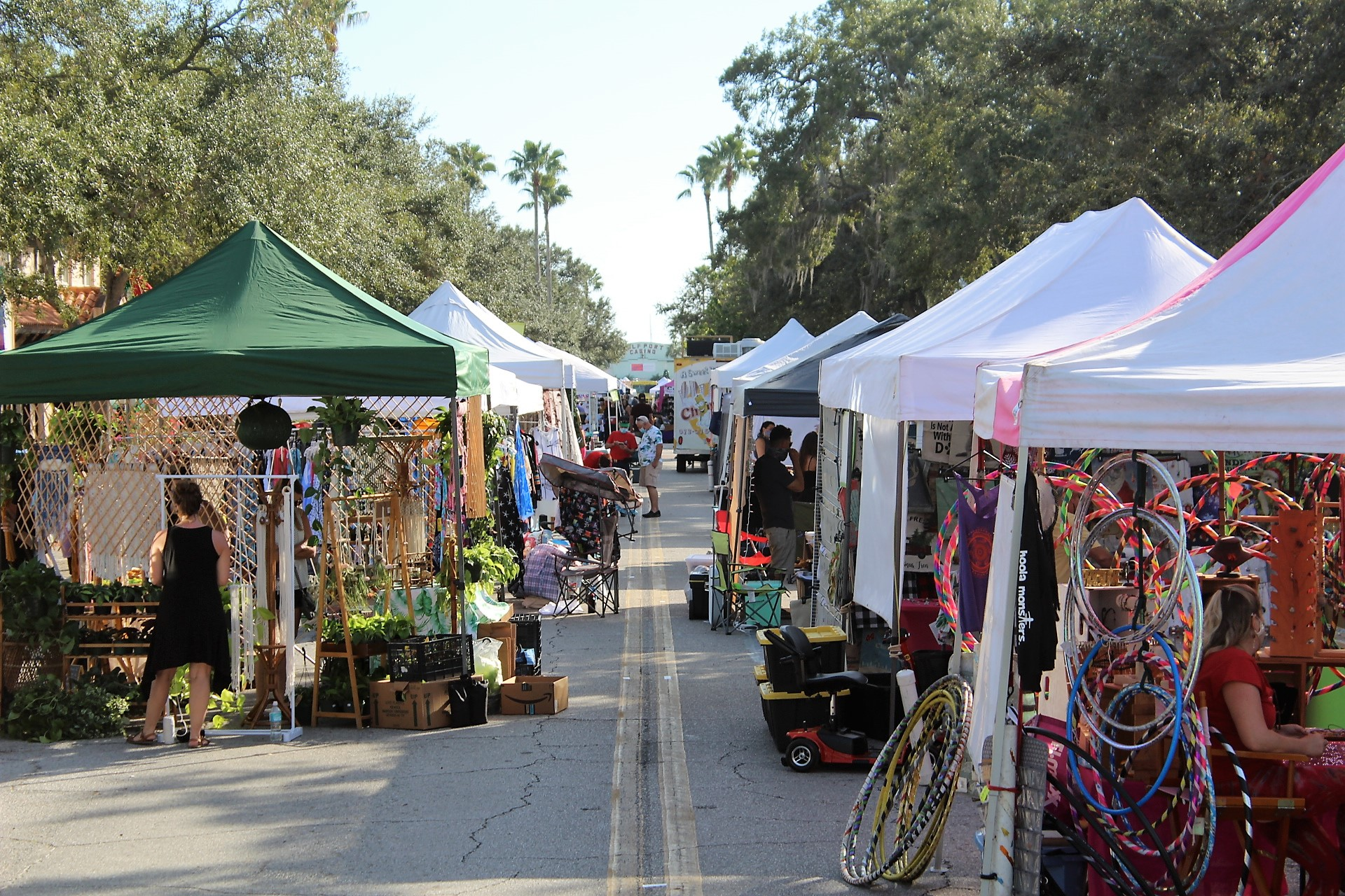 A row of vendor tents on a street.