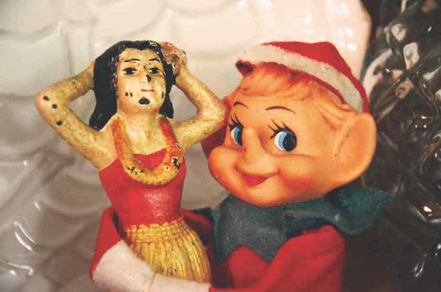 A vintage Elf doll hugging a vintage mermaid figure