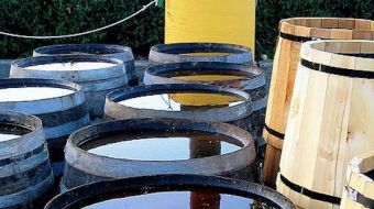 A row of full rain barrels