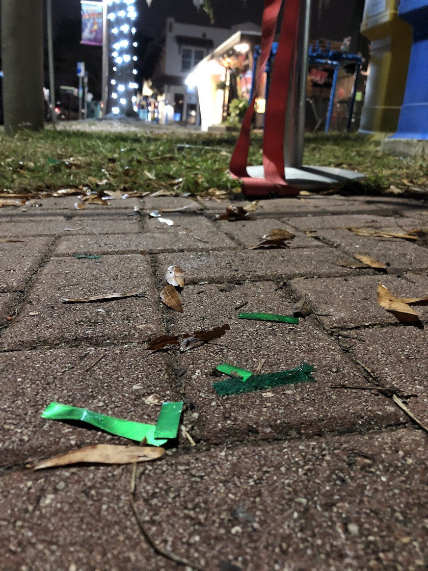 Green plastic strips on the ground.