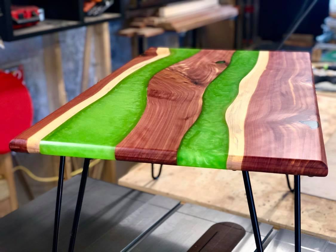 A wood and green epoxy table
