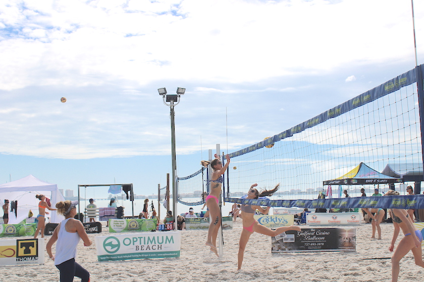 Women playing volleyball on the beach