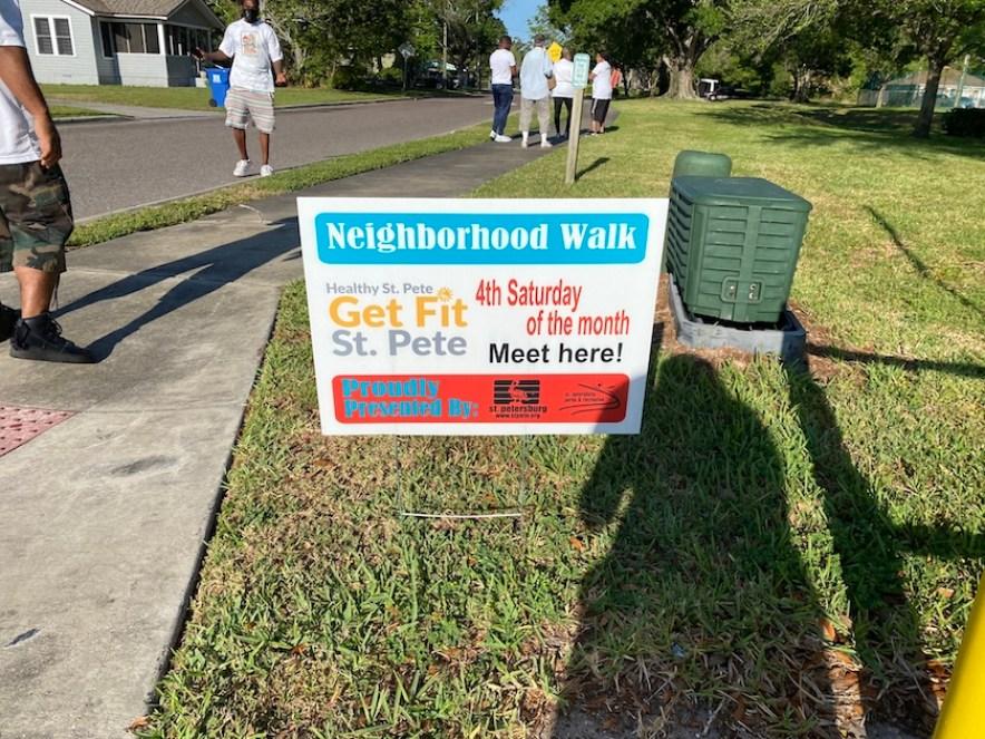 A sign for a neighborhood wellness walk