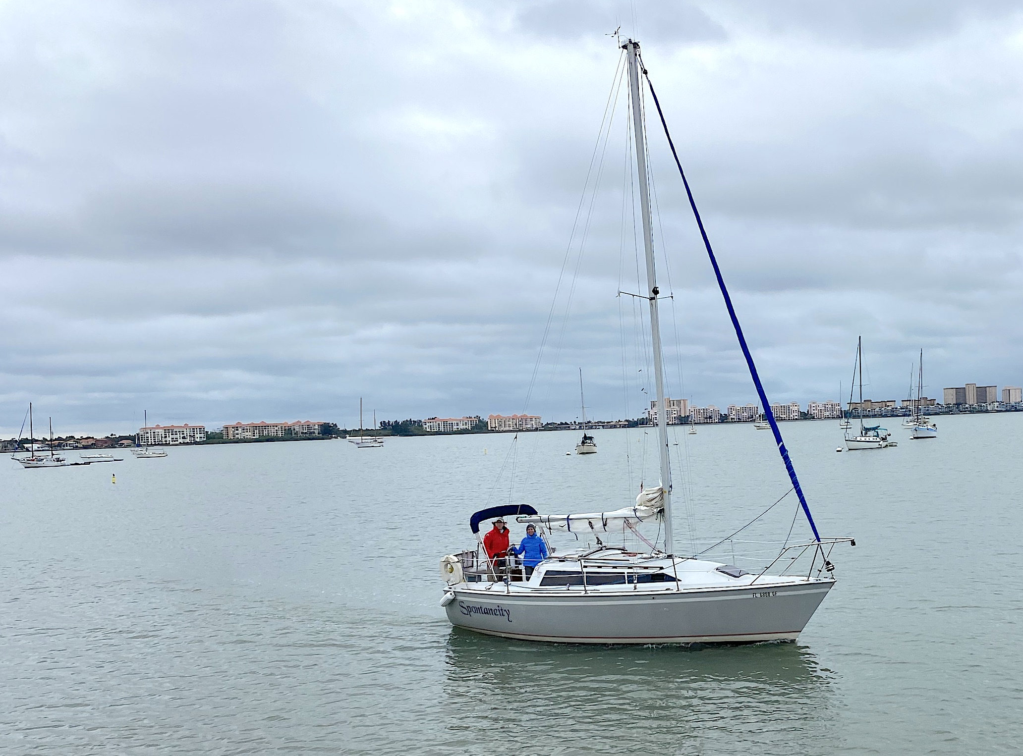 A Boat in a by on an overcast day