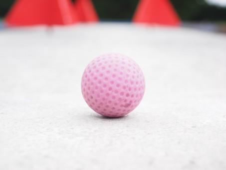 Pink mini golf ball